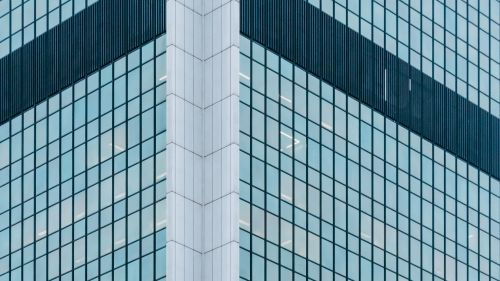 Facade of a glassy building HD Wallpaper