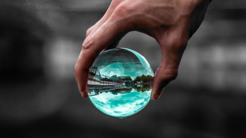Glass ball on hand HD Wallpaper