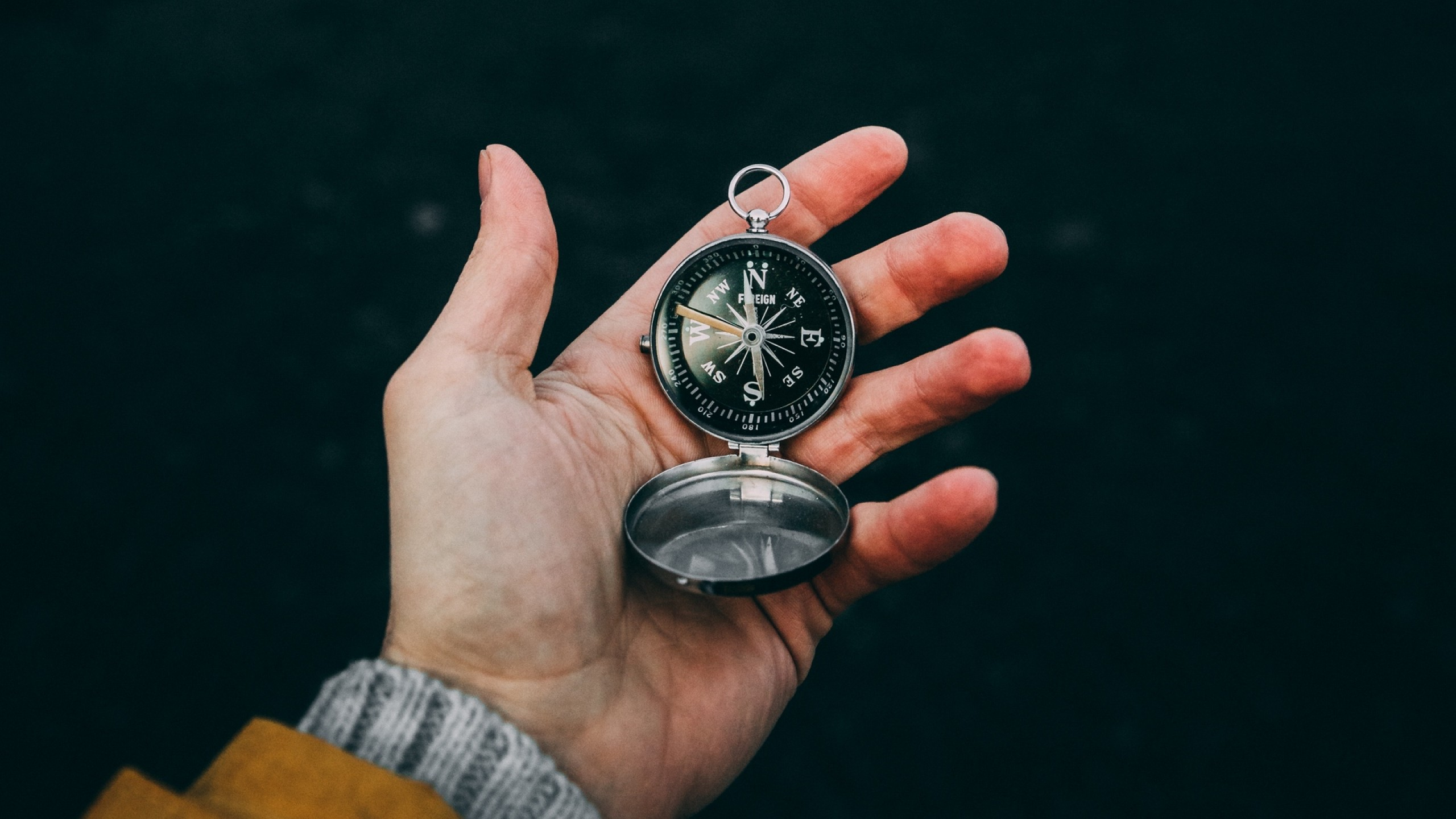 Compass at the hand of tourist HD Wallpaper Youtube Cover Ph
