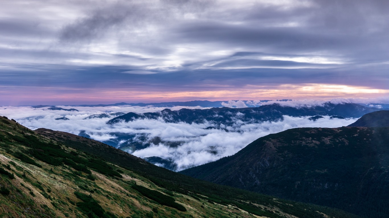 Sunset Over The Top Of The Mountains Hd Wallpaper 1366x768