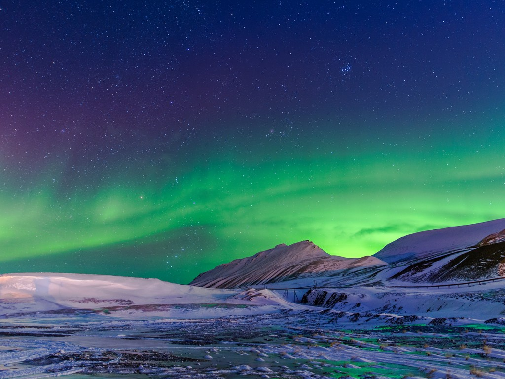 aurora borealis and snowy mountains 1024x768 - hd wallpaper