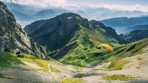 Paraglider in Mountains HD Wallpaper