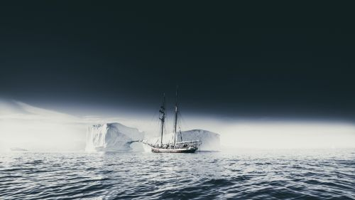 Ship sailing through an iceberg HD Wallpaper