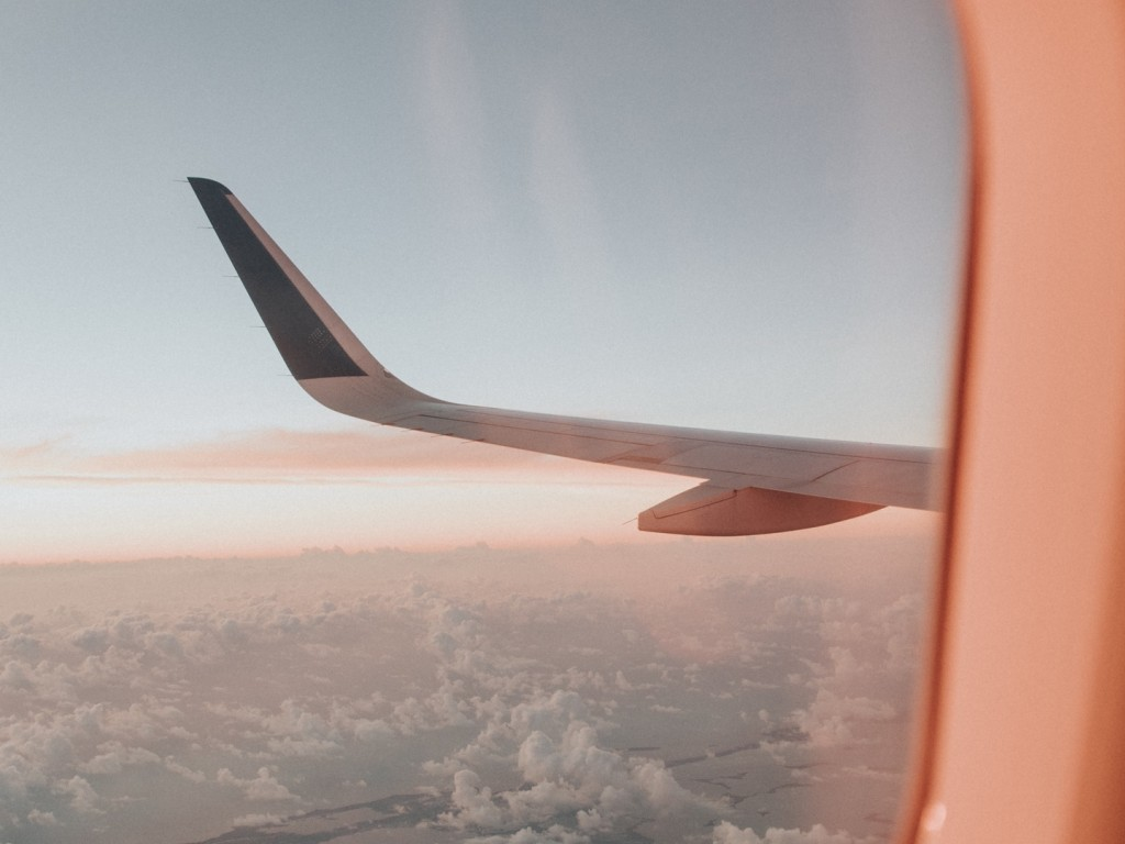 Wing outside of aircraft's window HD Wallpaper